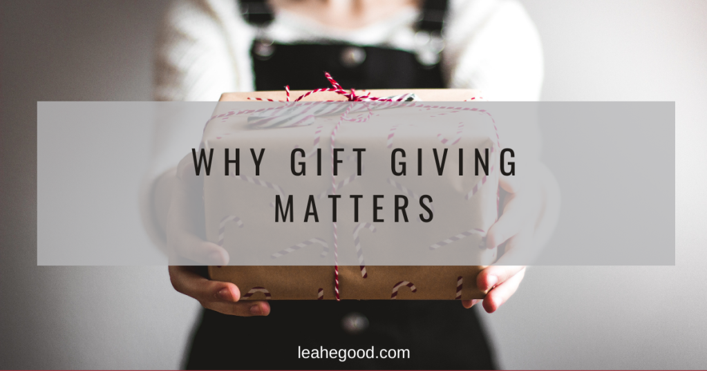 "Girl holding out a gift with the text, ""Why Gift Giving Matters"""